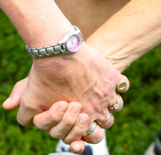 Close up of a couple's hands as they hold one another